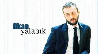 Актер Окан Ялабык фото